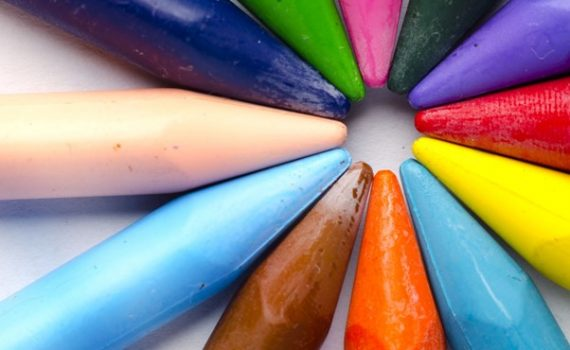 coloured crayons set with points joining to make a circle